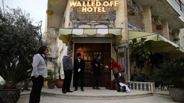 Banksy Opens Hotel Overlooking Bethlehem Wall In West Bank