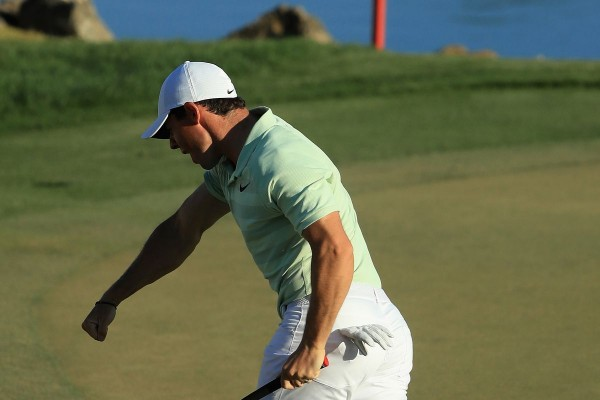 Rory Mcilroy Follows Tiger Woods' Lead On His Way To A Win At Bay