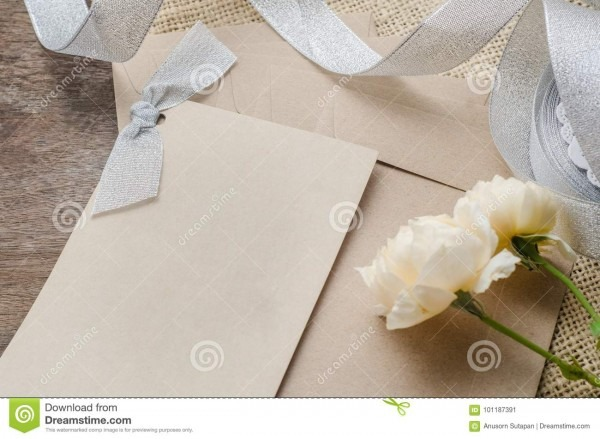 Blank Invitation Card With Brown Envelope And Rose Flowers On