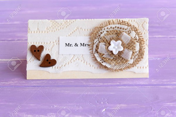 Vintage Wedding Invitation On Lilac Wooden Background  Homemade