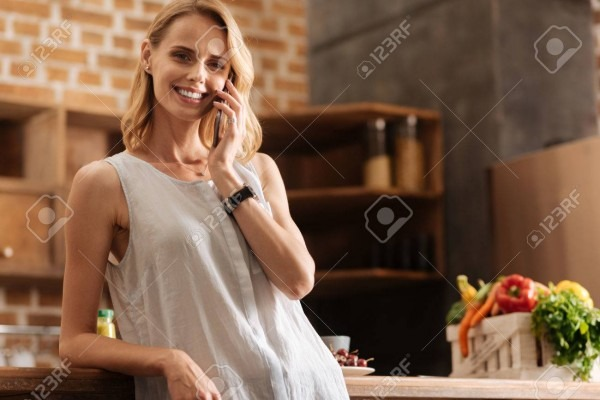 Cheerful Energetic Woman Inviting Friends For Dinner Stock Photo